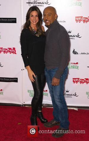 Montel Williams with wife Tarra  The 80th Anniversary of The Hollywood Christmas Parade benefiting Marine Toys For Tots on...