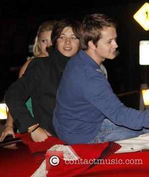 Jason Earles anf Olivia Holt and Leo Howard The 80th Anniversary of The Hollywood Christmas Parade benefiting Marine Toys For...