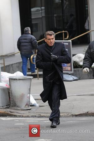 Pierce Brosnan filming on the set of her new movie 'I Don't Know How She Does It' in Manhattan New...