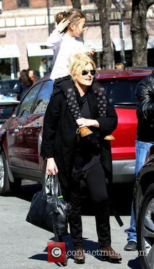 Deborra-Lee Furness and Ava Eliot Jackman Deborra-Lee Furness walking in Manhattan on a sunny day with her daughter on her...