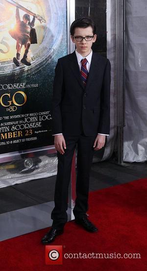 Asa Butterfield,  at the 'Hugo' premiere shown at the Ziegfeld Theatre. New York City, USA - 21.11.11