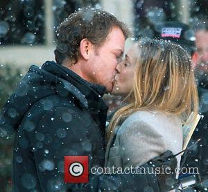 Greg Kinnear and Sarah Jessica Parker  sharing a kiss on the set of 'I Don't Know How She Does...