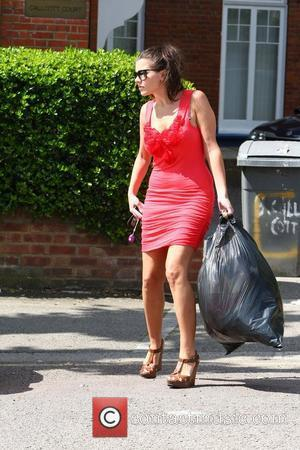 Imogen Thomas takes her rubbish outside before dropping off a friend at the station  London, England - 03.06.11