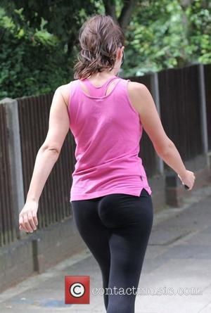 Imogen Thomas goes for a run wearing leggings and a pink vest top London, England - 20.06.11