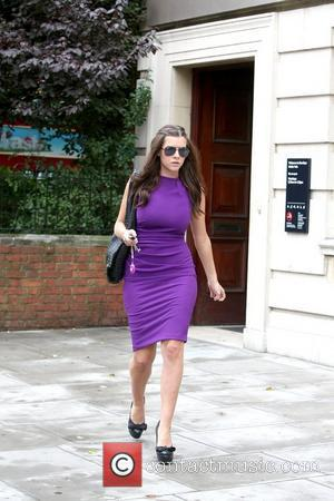 Imogen Thomas  out and about in Central London wearing a purple dress London, England - 08.07.11
