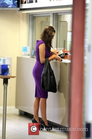 Imogen Thomas  stopping at a bank while running errands in Central London London, England - 08.07.11
