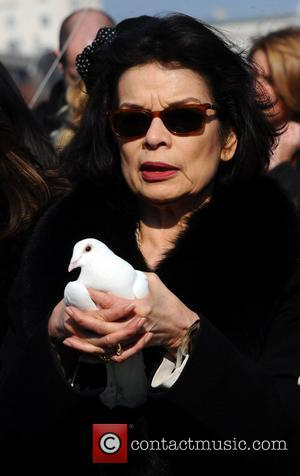 Bianca Jagger  attend photocall ahead of a march in aid of International Women's Day at the Millennium Bridge London,...