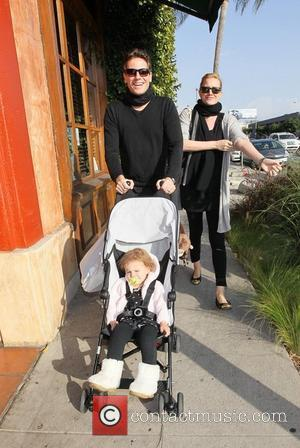 Ioan Gruffudd and Alice Evans with their daughter Ella walking past Pane E Vino restaurant in West Hollywood West Hollywood,...