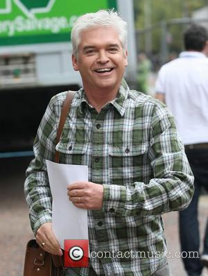 Phillip Schofield leaving the ITV studios after presenting 'This Morning', where he made an innuendo following an EastEnders clip with...