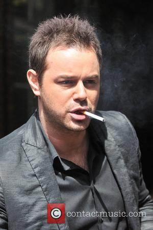 Danny Dyer smoking a cigarette  Celebrities outside the ITV television studios London, England - 19.05.11