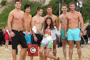 Imogen Thomas filming with 'Hunks in Trunks' for 'This Morning' on Bournemouth Beach Bournemouth, England - 25.08.11