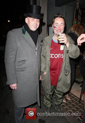Violinist Nigel Kennedy appears in high spirits as he leaves the Ivy restaurant after watching his team Aston Villa win...