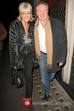 Comedian Bobby Davro out with a female companion celebrating Valentine's night at the Ivy Club. London, England - 14.02.11