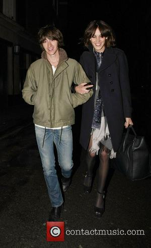 Alex Turner and Alexa Chung Celebrities leave The Ivy Club having earlier attended the NME Awards 2011 London, England -...