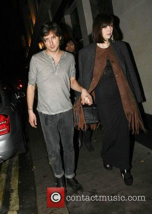 Carl Barat and Edie Langley  Celebrities leave The Ivy Club having earlier attended the NME Awards 2011 London, England...