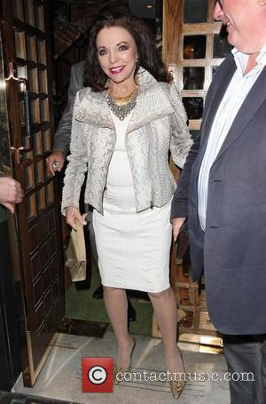 Joan Collins and Christopher Biggins leaving Ivy restaurant after eating a late dinner. Collins has been forced to sell one...