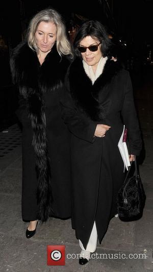Bianca Jagger and a female friend leaving J Sheekey restaurant. London, England - 08.03.11