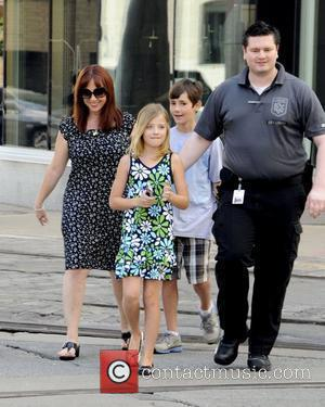 Singing phenom Jackie Evancho  along with her mother Lisa Evancho and brother Jacob Evancho are escorted by security to...