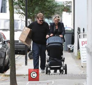 James Corden and his wife Julia Carey take their son Max out for some fresh air. London, England - 05.09.11