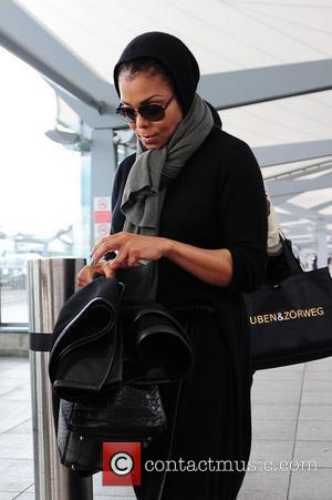 Janet Jackson arriving at Heathrow Airport London, England - 30.06.11
