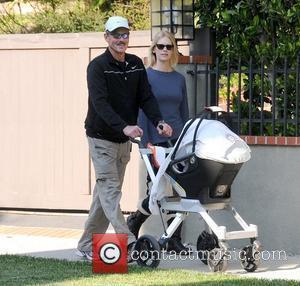 Marvin Jones, Xander Dane Jones and January Jones new mother January Jones walking with her father in Los Feliz, as...