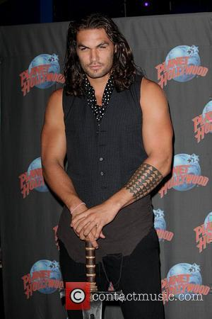 Jason Momoa promotes his starring role in 'Conan the Barbarian' with a hand print ceremony at Planet Hollywood in Times...