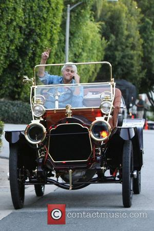 Jay Leno drives through Beverly Hills in a vintage classic automobile Beverly Hills, Los Angeles - 12.02.11