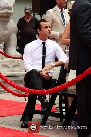 Justin Theroux Jennifer Aniston is honoured with a Hand and Footprint Ceremony outside Grauman's Chinese Theatre, while her boyfriend looks...