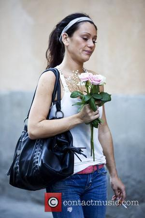 Jenni Farley aka JWoww 'Jersey Shore ' cast member holding flowers that were delivered to her Florence residence earlier in...