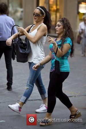 Jenni Farley aka JWoww and Deena Nicole Cortese 'Jersey Shore ' cast member JWoww smoking after she threw flowers off...