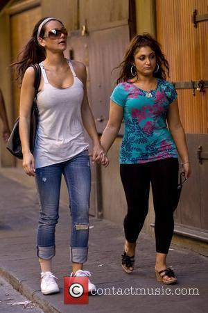 Jenni Farley aka JWoww and Deena Nicole Cortese 'Jersey Shore ' cast member JWoww holding hands with Deena Nicole Cortese...