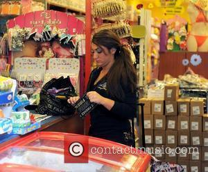 Deena Nicole Cortese 'Jersey Shore' cast members visit the Tutto 99 cent store, to pick up various household essentials, including...