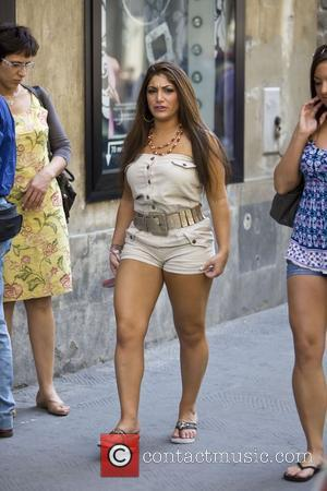 Deena Nicole Cortese and Sammi 'Sweetheart' Giancola of Jersey Shore are frightened by pigeons as they walk through Piazza del...