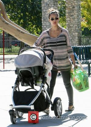 Jessica Alba pushes baby Haven Warren in a stroller as she enjoys some family time at a park in Beverly...