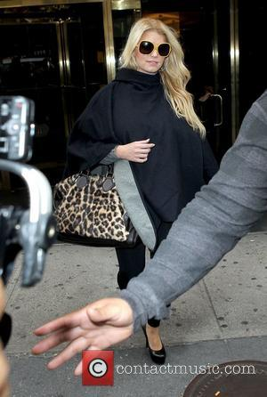 Jessica Simpson all covered up as she leaves Bergdorf Goodman with her sister New York City, USA - 24.10.11