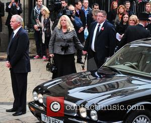 Mourners and Jimmy Savile