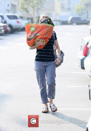 Jodie Foster hides her face with her reusable grocery bag after shopping at Bristol Farms in Beverly Hills Beverly Hills,...