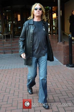 Def Leppard frontman Joe Elliott  seen leaving The Westbury Hotel  Dublin, Ireland - 07.04.11