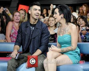 Joe Jonas Keen To Tour With Chris Brown