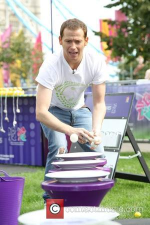 Joe Swash  filming the gameshow 'Cadbury spots vs stripes' at the Thames Festival London, England - 10.09.11
