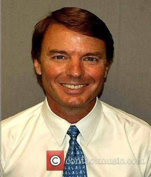 John Edwards Former senator and vice presidential nominee smiles for his mug shot. Edwards was indicted on federal charges in...