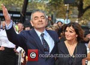 Rowan Atkinson and Sunetra Sastry Johnny English Reborn - UK film premiere held at the Empire Leicester Square - Arrivals...