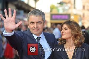 Rowan Atkinson and Lily Atkinson Johnny English - UK film premiere held at the Empire Leicester Square - Arrivals. London,...