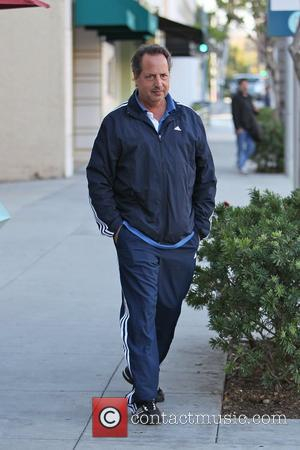 Jon Lovitz  is seen waiting for his car on Canon Drive in Beverly Hills. Los Angeles, California - 01.02.11