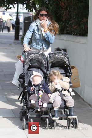 Jools Oliver  walking in Primrose Hill with her children London, England - 03.05.11