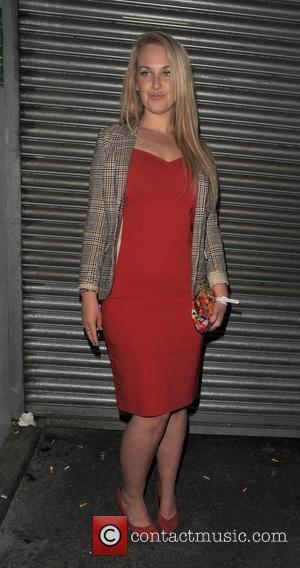 Josie Gibson leaving Merah nightclub. Josie showed off her slimmed down body in a tight red dress. London, England -...