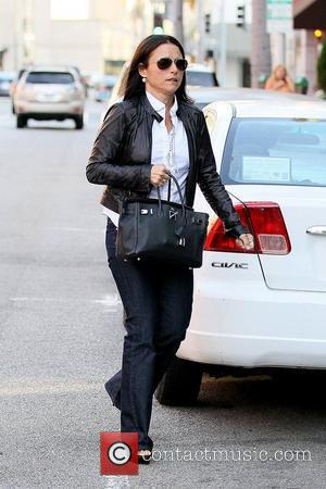 Julia Louis-Dreyfus in good spirits as she leaves a medical building in Beverly Hills Los Angeles, California - 20.09.11