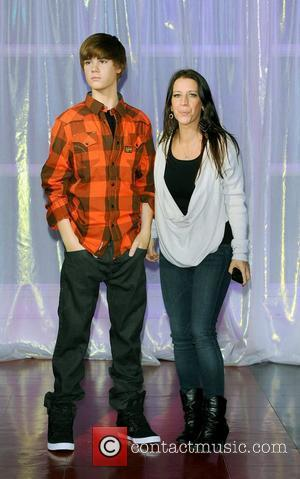 Justin Biebera and his mother, Patty Lynn Mallette at his waxwork unveiling held at Madame Tussauds. London, England - 15.03.11