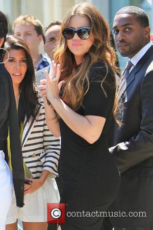 Kourtney Kardashian, Khloe Kardashian  Kim Kardashian's family wait along with Vera Wang for the reality TV star to arrive...