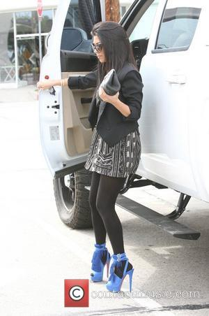 Kourtney Kardashian getting out of her truck in Beverly Hills Los Angeles, California - 07.04.11